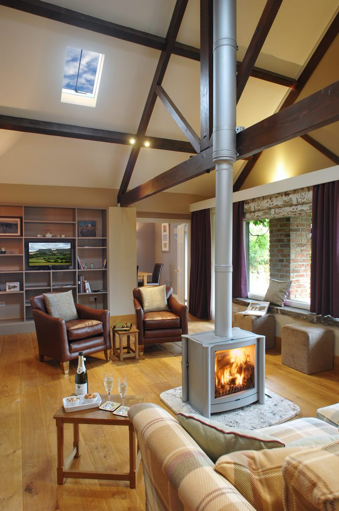 Cosy fireside seating; chairs and sofa around a wood burning stove