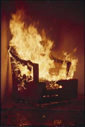 Photo of chair on fire - one that did not meet fire safety regulations